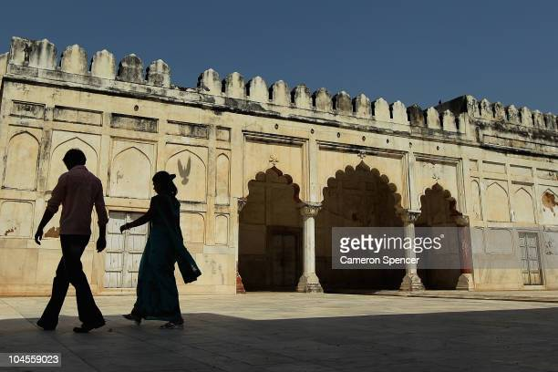 Tourists walk through the Red Fort in Old Delhi ahead of the Delhi 2010 Commonwealth Games on September 30 2010 in Delhi India