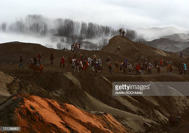Tourists walk towards the caldera of Mount Bromo during the Yadya Kasadha ceremony in the ancient volcano complex the Tengger in Probolinggo East...