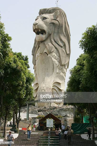 Tourists walk under Merlion statue on Sentosa Island resort in Singapore 23 April 2005 A former British colonial fortress which has been struggling...