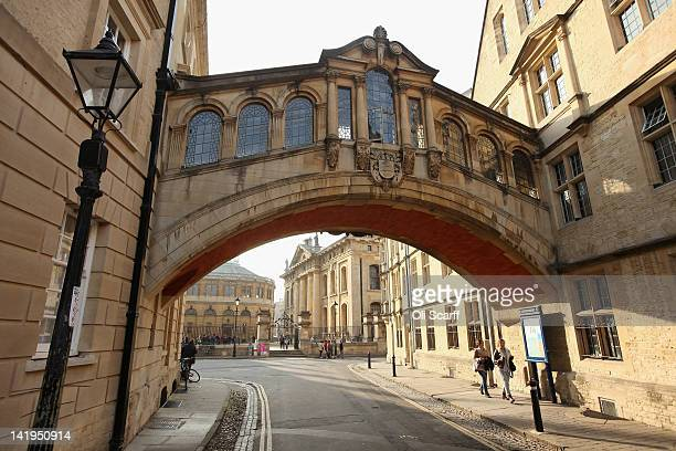Tourists walk under the Bridge of Sighs along New College Lane on March 22 2012 in Oxford England