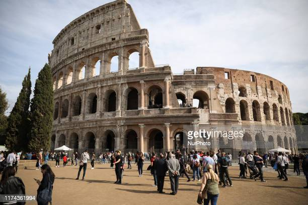 Tourists walking ahead of Coloseum in Rome Italy