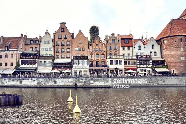 tourists walking along motlawa river in gdansk - motlawa river stock pictures, royalty-free photos & images