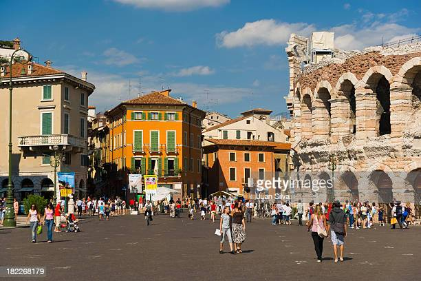 Tourists walking by Verona arena