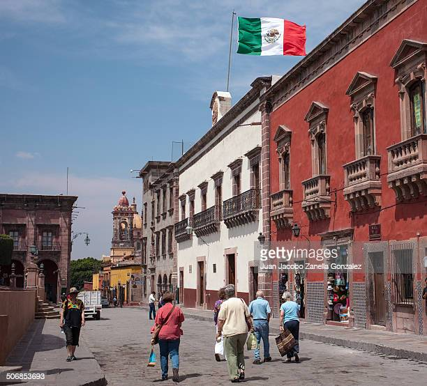 Tourists walking down the streets of the historic city and World Heritage Site of San Miguel de Allende, Guanajuato State, Mexico.