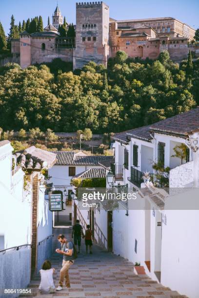 tourists walking in albaicin area in granada,spain - granada spain landmark stock pictures, royalty-free photos & images