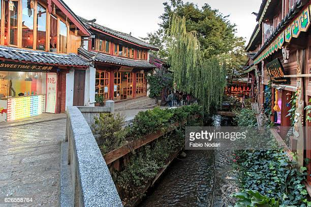 Tourists walking in the old town of Lijiang during sunset