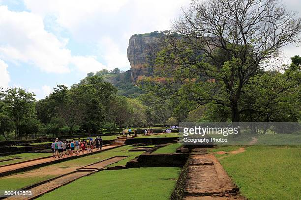 Tourists walking in the palace water gardens Sigiriya Rock palace Central Province Sri Lanka Asia