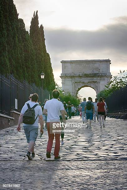 Tourists walking in the Roman Forum in Rome, Italy