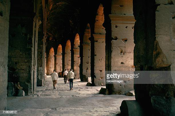 tourists walking inside a coliseum, rome, italy - inside the roman colosseum stock photos and pictures