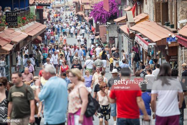tourists walking on main street in town of side antalya - antalya province stock pictures, royalty-free photos & images