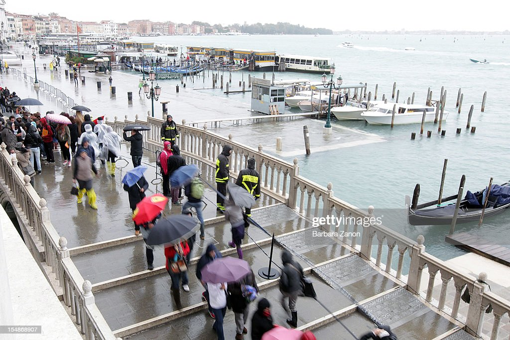 Tourists walking on the Ponte della Paglia during high tide on the day of the Venice Marathon at Piazza San Marco on October 28, 2012 in Venice, Italy. The high tide or acqua alta stood at 123 centimeters this morning.