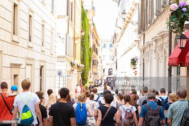 Tourists walking the downtown streets of Rome, Italy