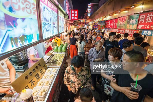 Tourists walking through Donghuamen Snack Market