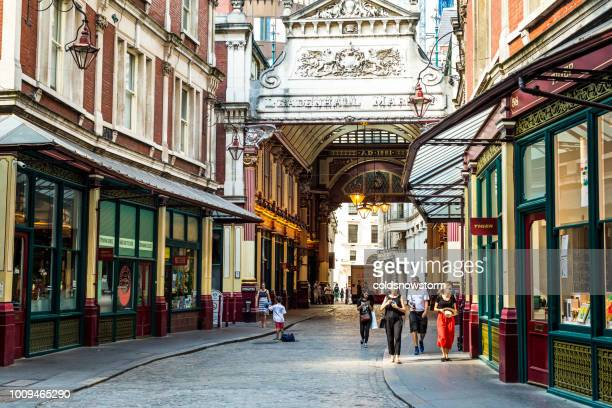 tourists walking through leadenhall market in london, uk - leadenhall market stock photos and pictures