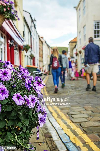 Tourists walking through the town of Staithes
