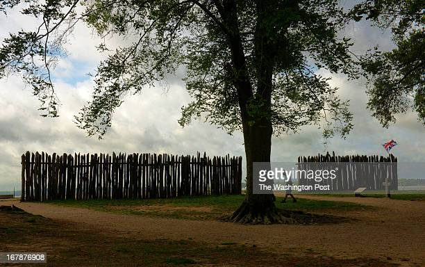A tourists walks past the wooden walls of the recreated fort at historic Jamestown during a visit for our travel story on April 2013 in Williamsburg...