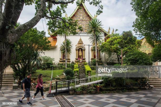 Tourists walks through Wat Phra That Doi Suthep in Chiang Mai Thailand on Wednesday July 4 2018 Thai inflation unexpectedly eased a bit in June from...