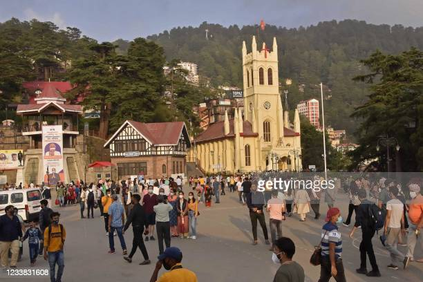 Tourists wander around the ridge area of Shimla in Himachal Pradesh state on July 6 as Indian government warned citizens against complacency as it...