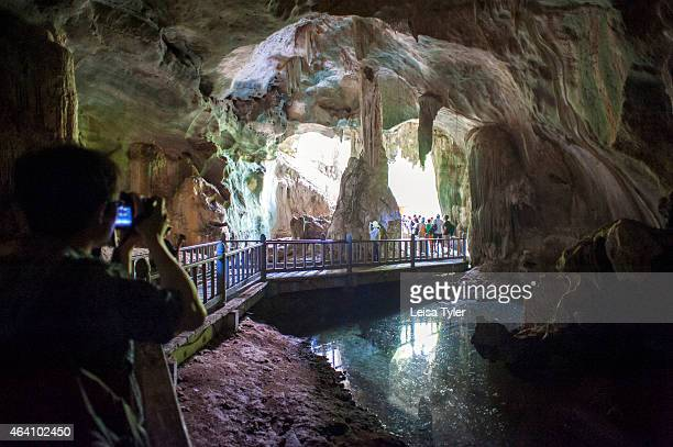 Tourists wander though the Bat Cave at the Kilim Karst Geoforest Park in Langkawi an island in north West Malaysia Formed more than half a billion...