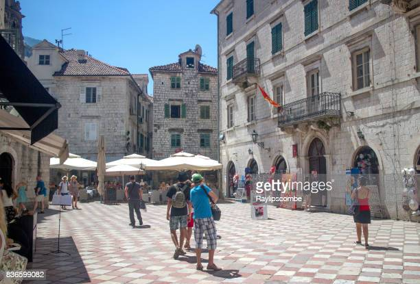 Tourists wandering around small shops in the town of Kotor in Montenegro