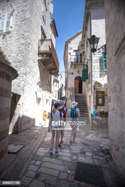 Tourists wandering around small shops Kotor