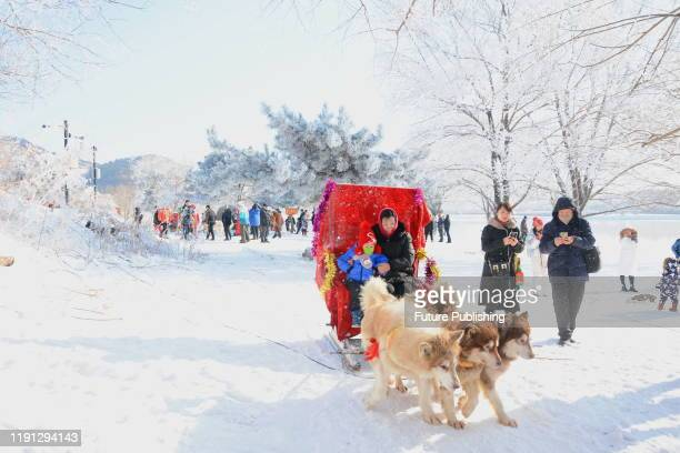 Tourists watch and photograph the new year's first rime landscape, Jilin City, Jilin Province, China, January 1, 2020. - PHOTOGRAPH BY Costfoto /...