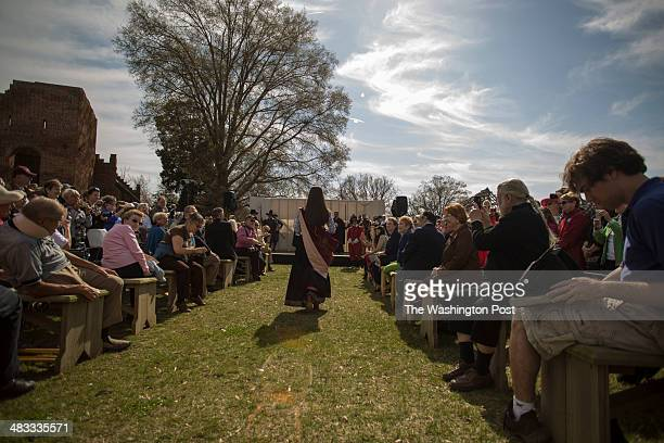 Tourists watch and take pictures as Wendy Taylor of King William Va proceeds to the stage to perform a ceremony commemorating the 400th anniversary...
