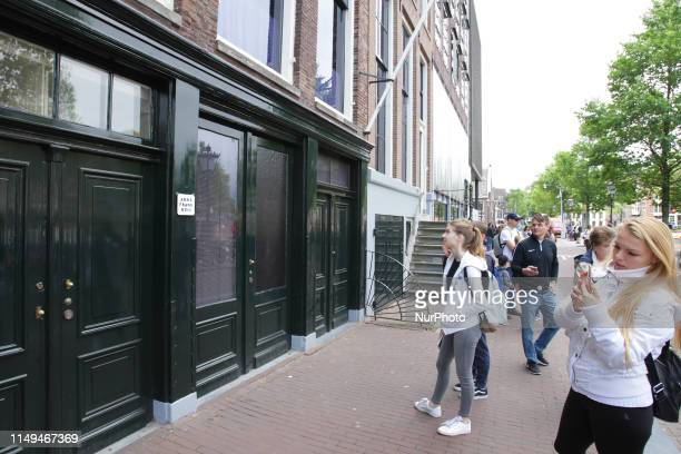 Tourists watch at the Prinsengracht canal the Anne Frank house and museum remembering Anne Frank's 90th Birthday on June 12 2019 in...