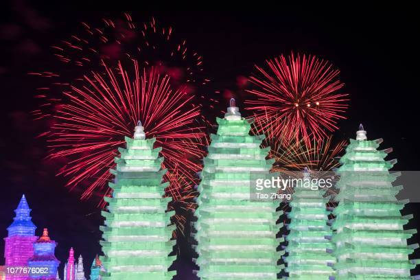 Tourists watch fireworks at the Harbin ice and snow world at Ice and Snow World park on January 5 2019 in Harbin China The Ice and Snow World Park...