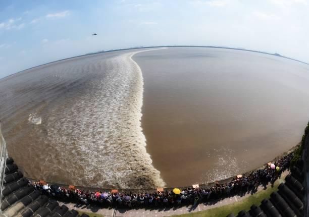 CHN: Tourists Watch Qiantang River Tide In Zhejiang