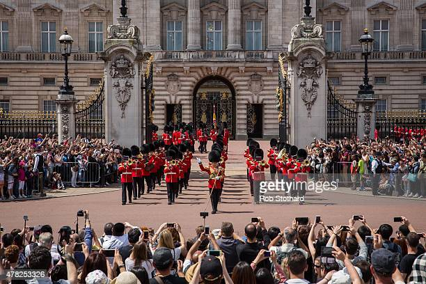 Tourists watch the Changing of the Guard at Buckingham Palace on June 24, 2015 in London, England. The Queen may have to move out of Buckingham...