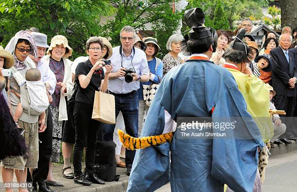 Tourists watch the parade during the Aoi Festival at Shimogamo Shrine on May 152016 in Kyoto Japan Aoi Festival is one of the three main festivals of...