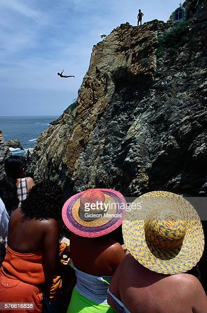 tourists watching cliff divers at la quebrada - guerrero stock pictures, royalty-free photos & images