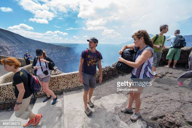 tourists  watching smoke coming out from volcano masaya crater in nicaragua. - masaya volcano stock pictures, royalty-free photos & images
