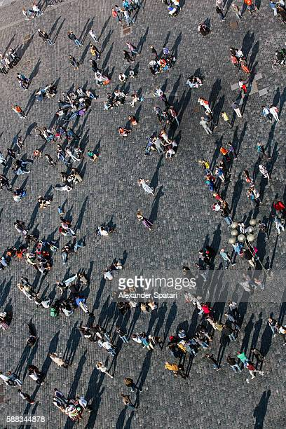 Tourists watching street perfrormers on the Old Town Square, elevated view, Prague, Czech Republic