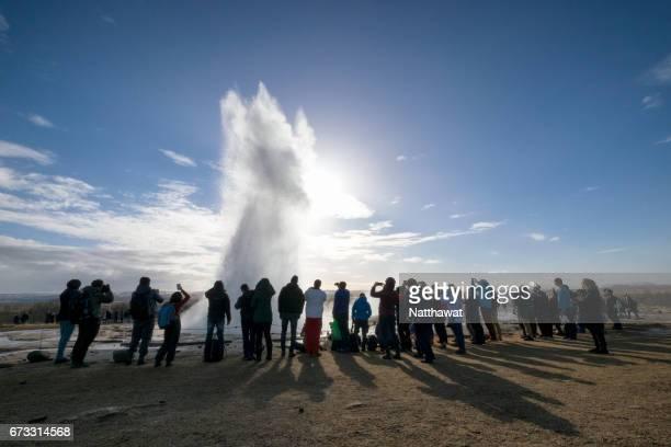Tourists watching Strokkur Geysir eruption in Golden Circle Iceland