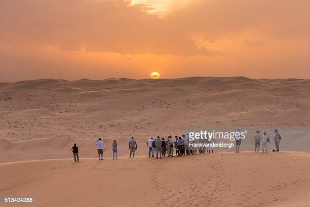 Tourists watching the desert sunset