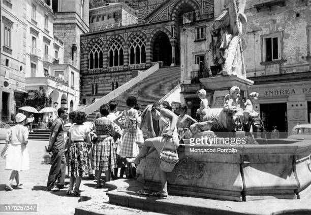 Tourists watching the Saint Andrew's Cathedral and its staircase Amalfi July 1960