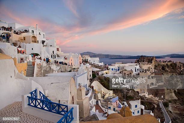 Tourists watching the sunset in Oia pronounced 'Ia' it is the most famous of all villages of Santorini It is world known for its quite life and...