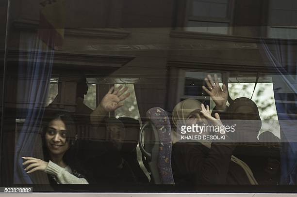 Tourists wave from a bus as they leave the Three Pyramids hotel in Cairo's alHarm district on January 7 after gunmen fired at Egyptian policemen...