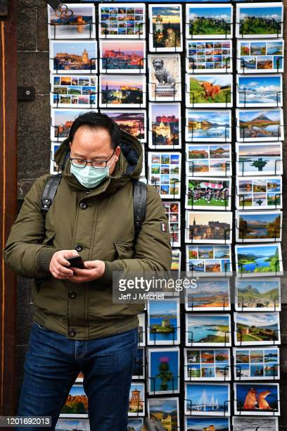 Tourists wear face masks as they visit Edinburgh Castle on January 24, 2020 in Edinburgh, Scotland. It has been confirmed that 14 people in Scotland...