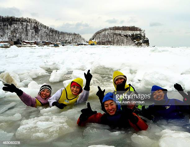 Tourists wearing dry suits go for a dip in the icy sea waters on February 8 2015 in Shari Hokkaido Japan Each winter000 to 5000 people visit the far...