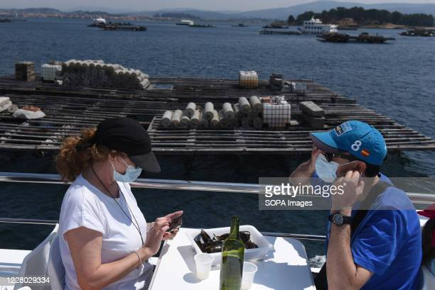 Tourists wearing face masks are seen on a tourist ship in O Grove O Grove is a fishing village which is situated on the mouth of the Arousa estuary...