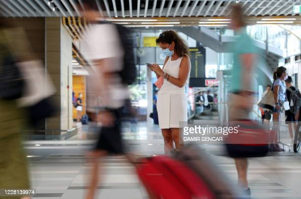 Tourists wearing face masks wait at Split International Airport in Split Croatia on August 21 2020 As United Kingdom removed Croatia from the list of...