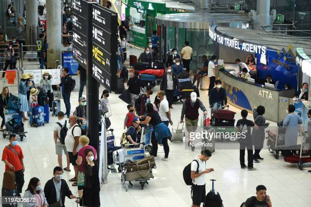 Tourists wearing protective masks walk at Suvarnabhumi Airport in Bangkok, Thailand, 29 January 2020.