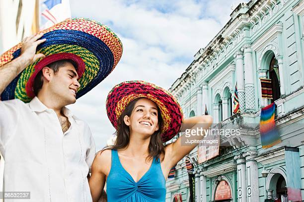 tourists wearing sombreros in merida, mexico - merida mexico stock photos and pictures