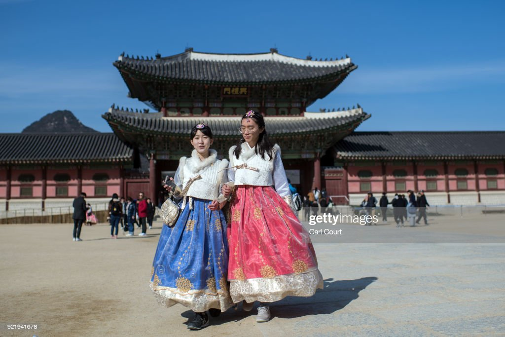 Tourists wearing traditional Korean Hanbok dresses visit Gyeongbokgung Palace on February 21, 2018 in Seoul, South Korea. With tourists visiting from around the world, leaders from South Korea's capital as well as GyeongGi and Gangwon Provinces have agreed to work together to support the PyeongChang Olympic Games and to invigorate regional tourism.