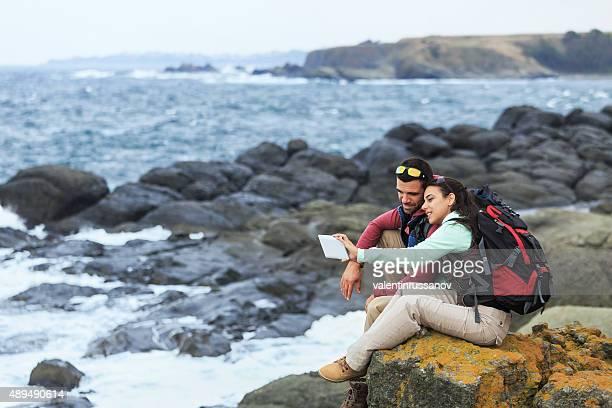 Tourists with backpacks enjoying