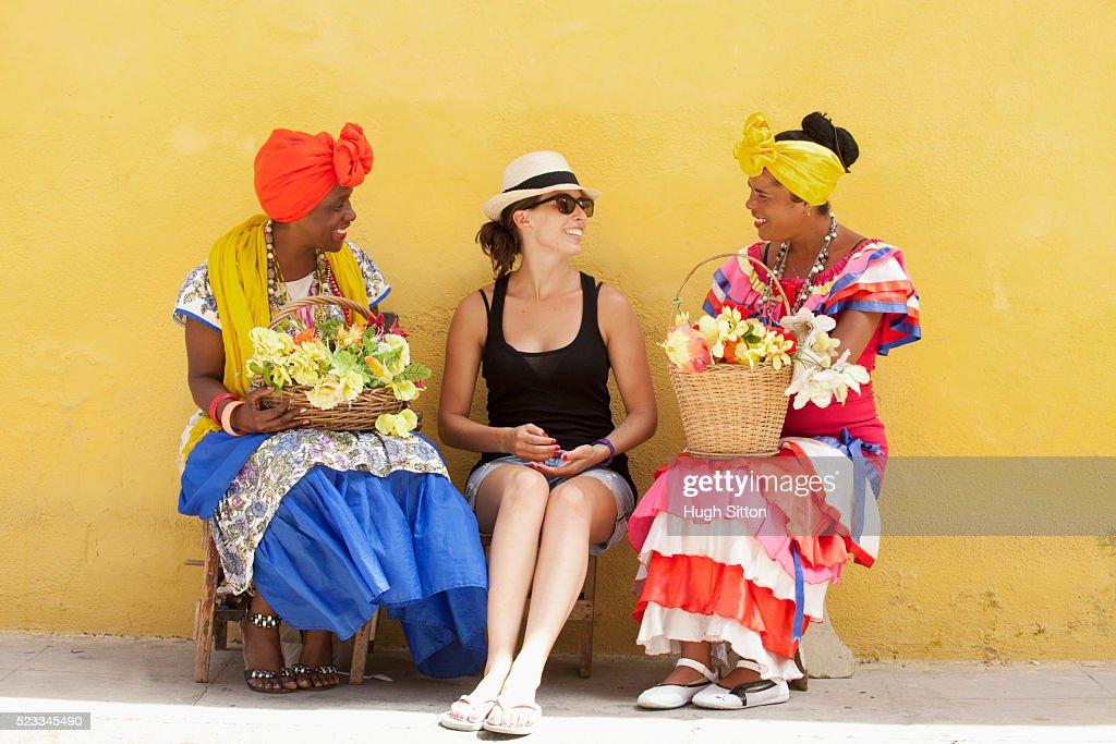 Tourists with Flower Ladies. Havana. Cuba. : Stock Photo
