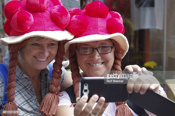 tourists with tradional Bollenhut doing selfie